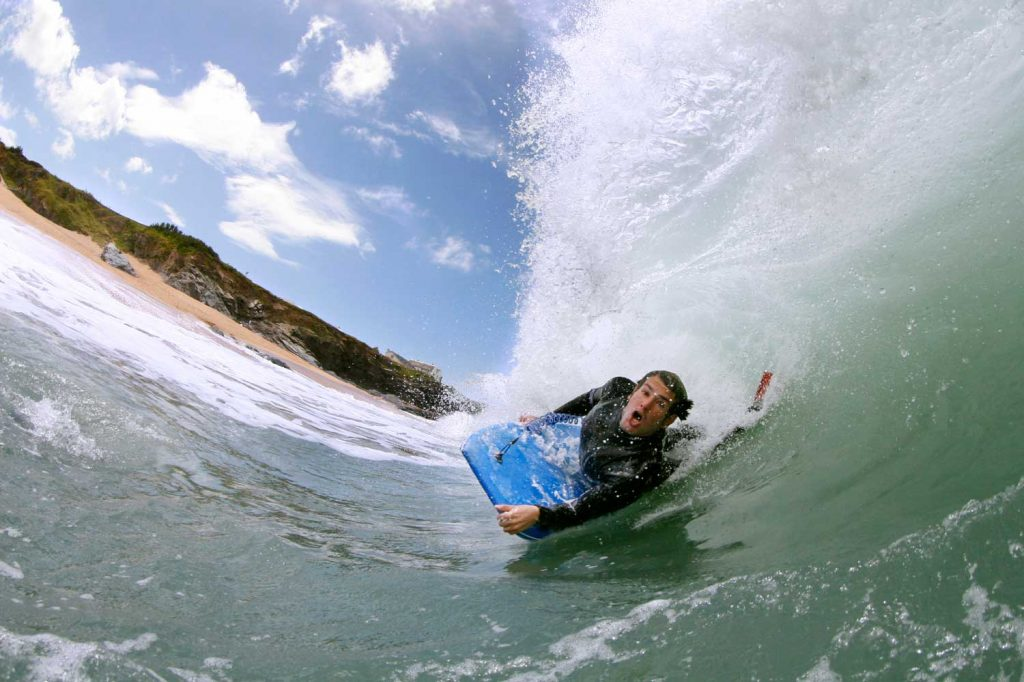 Bodyboarder riding the waves in Cornwall